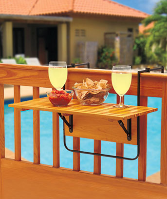 Folding Deck Table sets up in seconds and folds down flat when not in use. This attractive wood table comes with metal clamps and brackets that easily secure it to a porch or deck railing. Great for outdoor entertaining, the folding table is also ideal for decks or balconies with limited space.