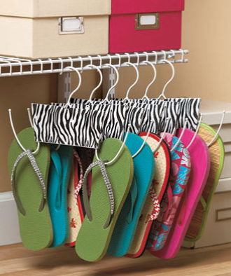 "Set of 6 Shoe Hangers keeps your flip-flops, flats and other shoes organized in your closet. Innovative hangers have a trendy design in the center and keep your shoes in sight and easily accessible. 11"" x 7"", each. Metal."