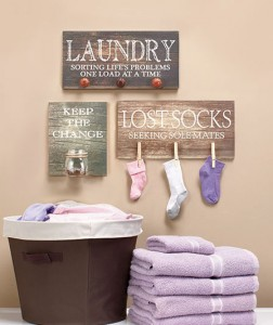 Lighten the load on laundry day with a funny yet functional Laundry Room Wall Hanging.