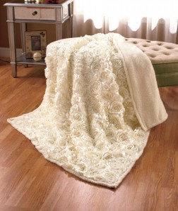 Take a room from simple to sophisticated by adding this 3-D Rosette Sherpa Throw.