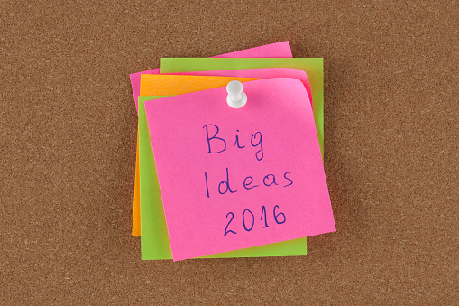 Color reminder note with pin on cork board big idea 2016.