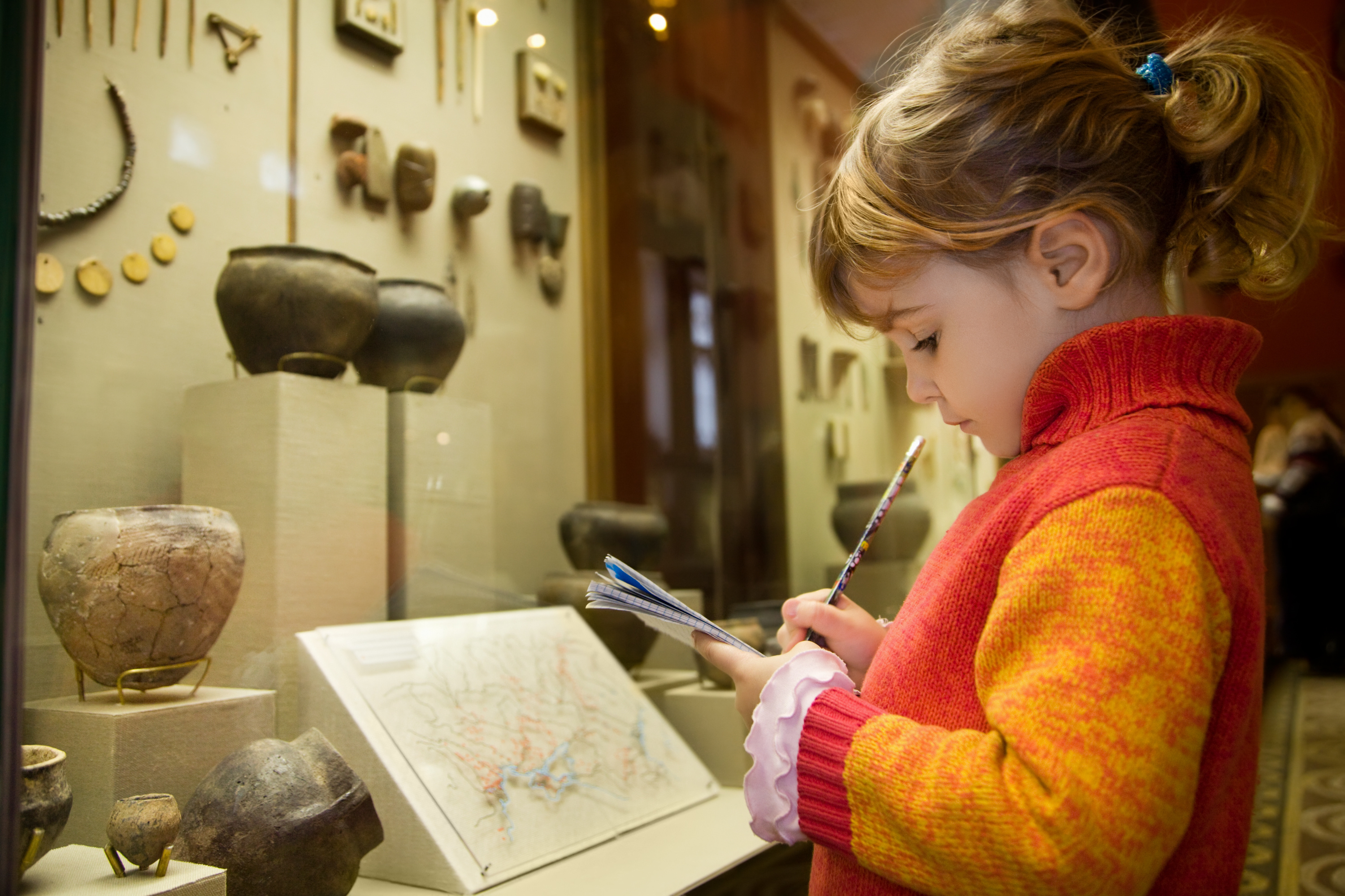 little-girl-writing-book-museum