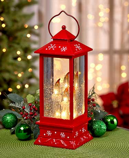 lighted-snowy-candle-lantern