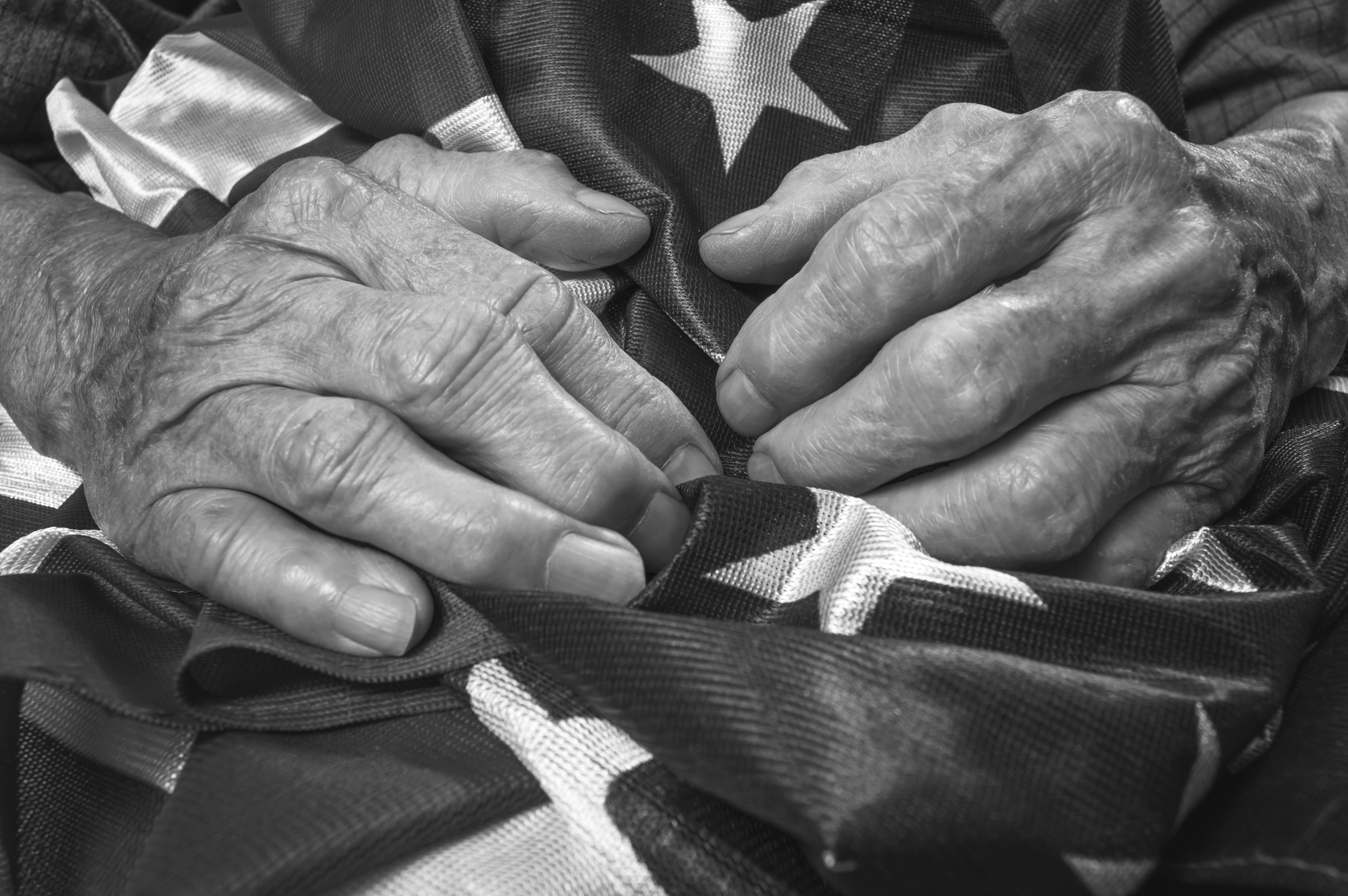 veterans-hands-on-American-flag