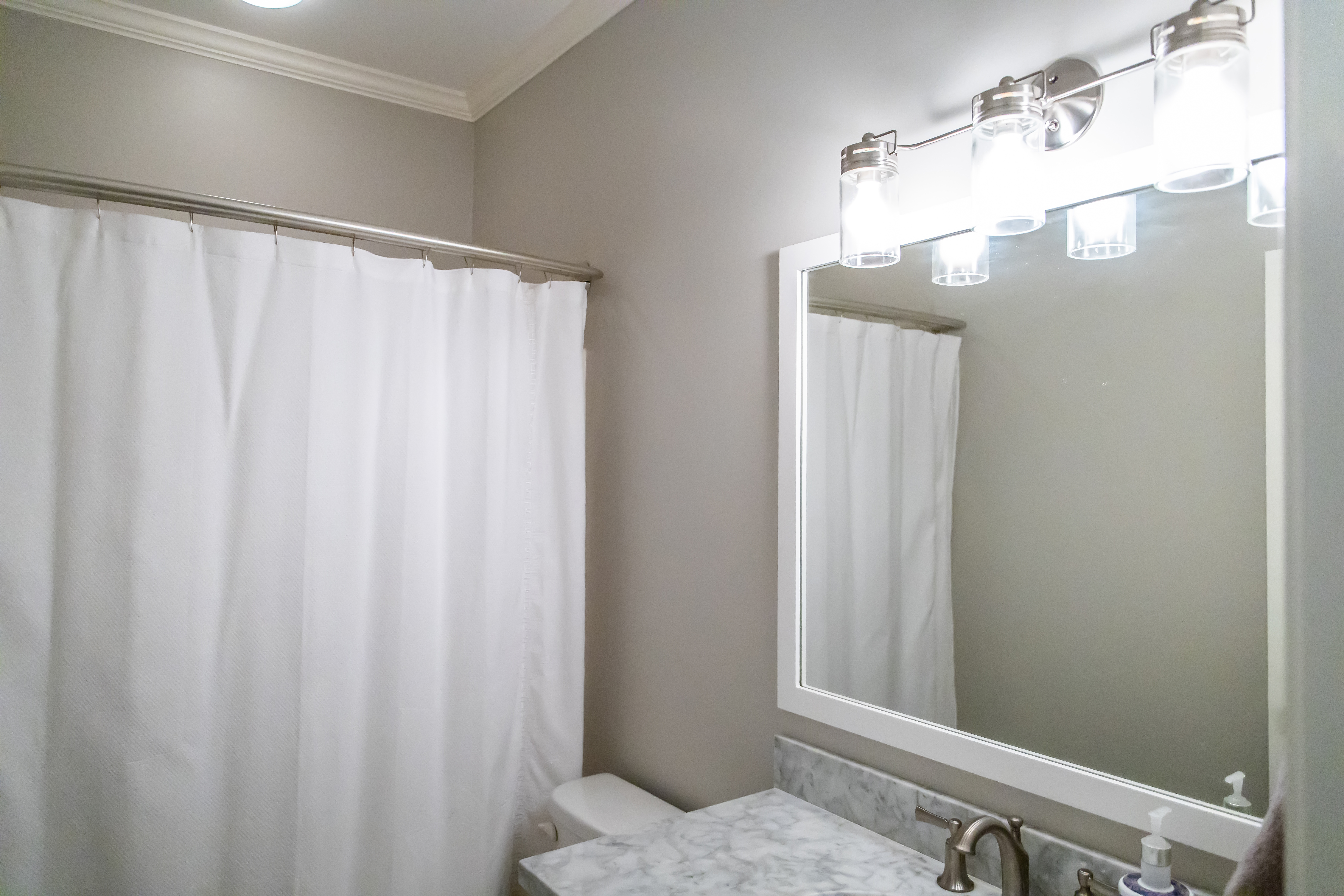 Small Bathroom Decorating Ideas - White Shower Curtain