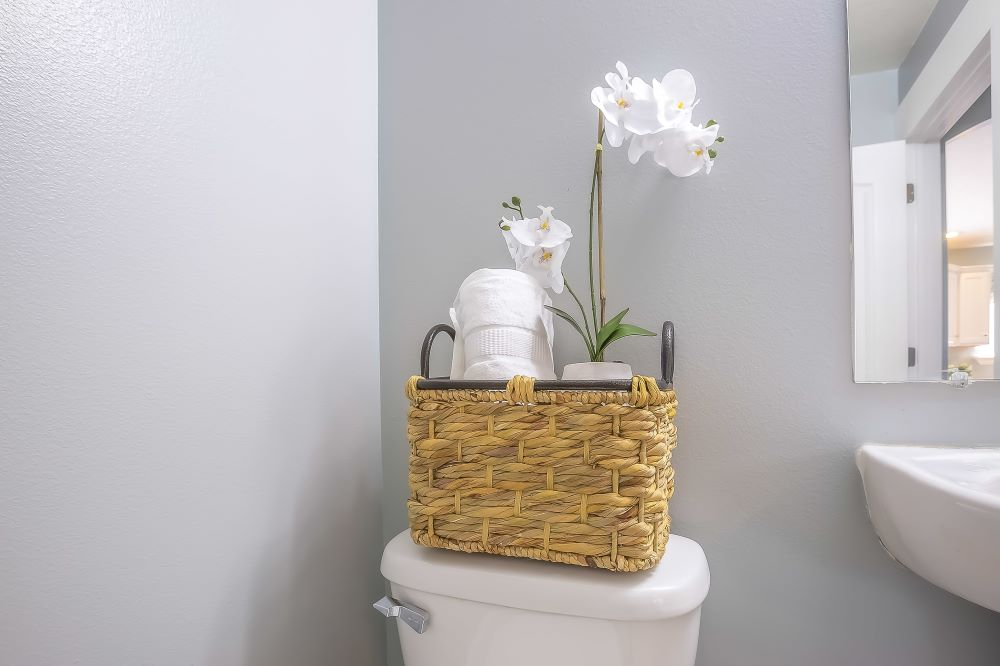 Storage Ideas For A Small Bathroom - Basket Of Toilet Paper