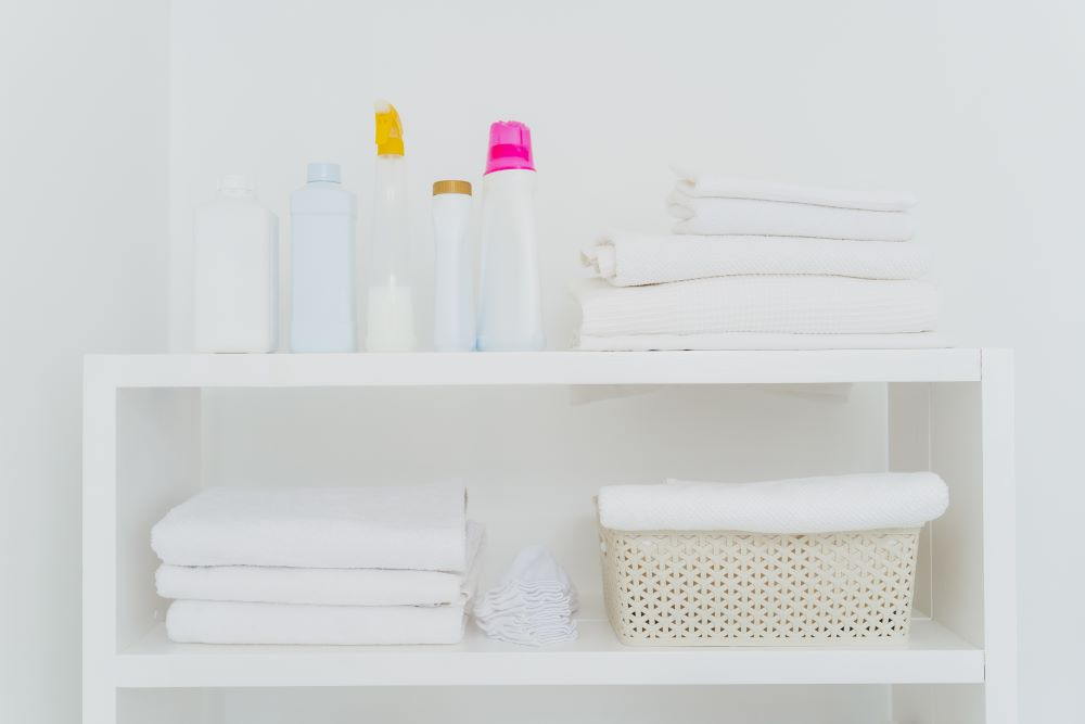 Organize A Laundry Room - Bookshelf With Folded Towels