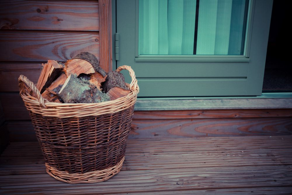 Wood Logs In Basket On Front Porch