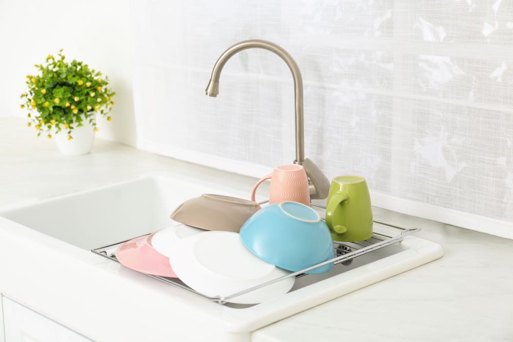 Use An In Sink Dish Drying Rack To Clear Up Countertop Space