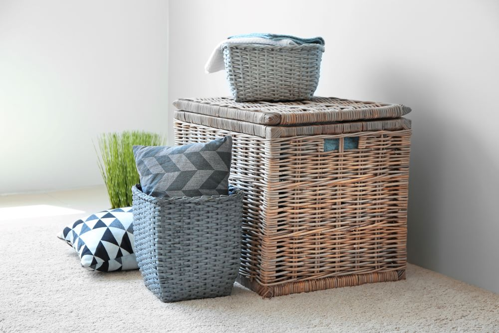 store extra pillows and blankets in baskets