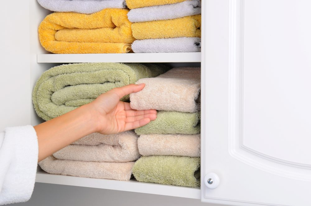 store towels in a wall cabinet