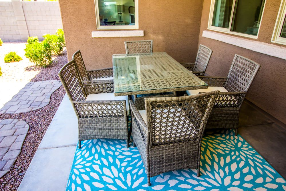 How to Create A Cozy Outdoor Living Space - Outdoor Rug and Cushions