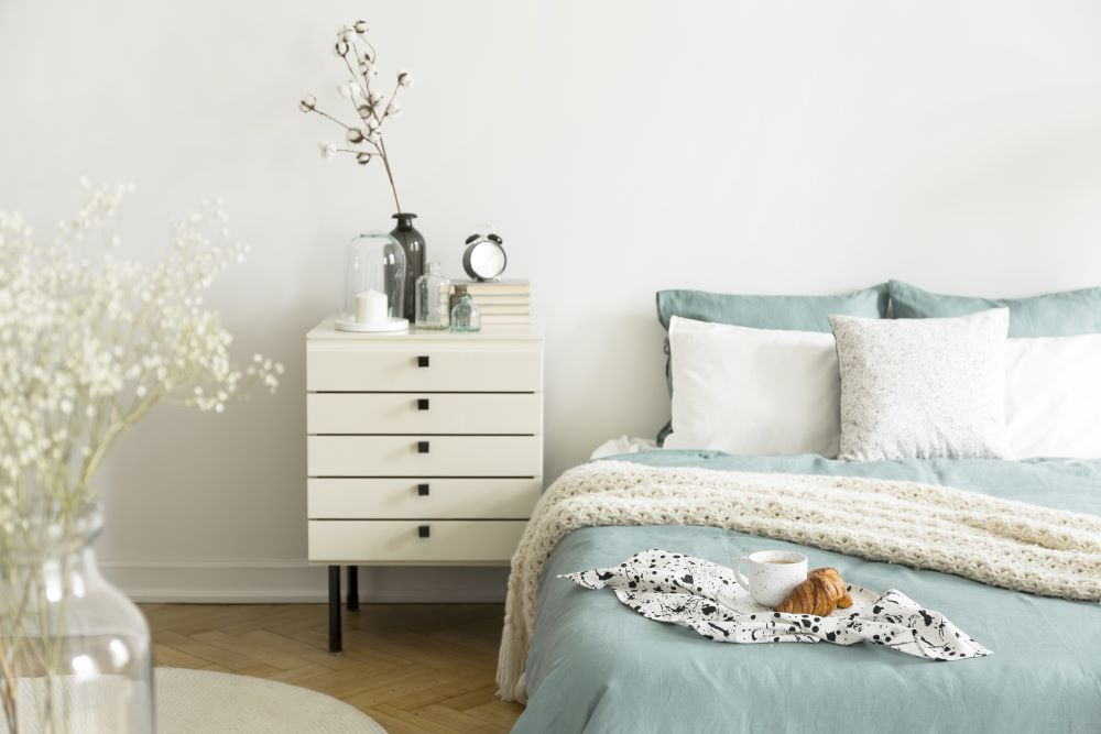 how to make your bedroom look luxurious - decorate your bedside table