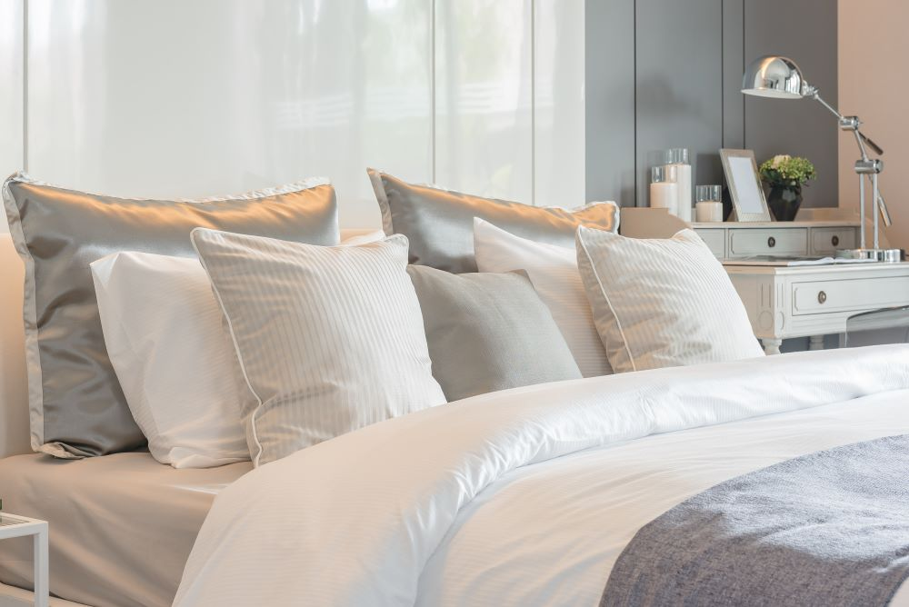 how to make your bedroom look luxurious - layer your pillows