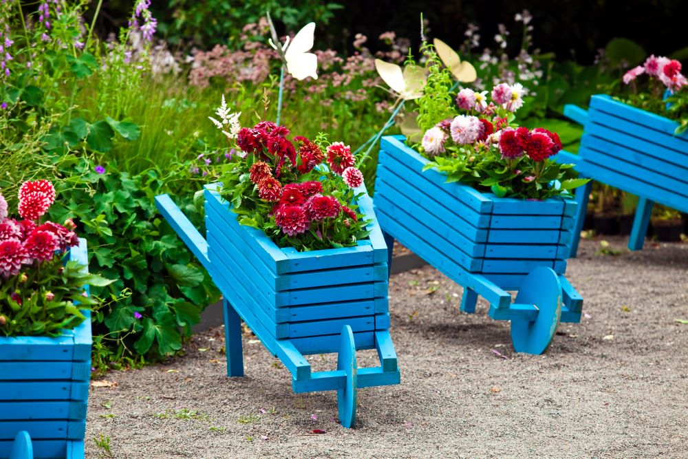 Make A Small Backyard Look Bigger - decorate with colorful planters