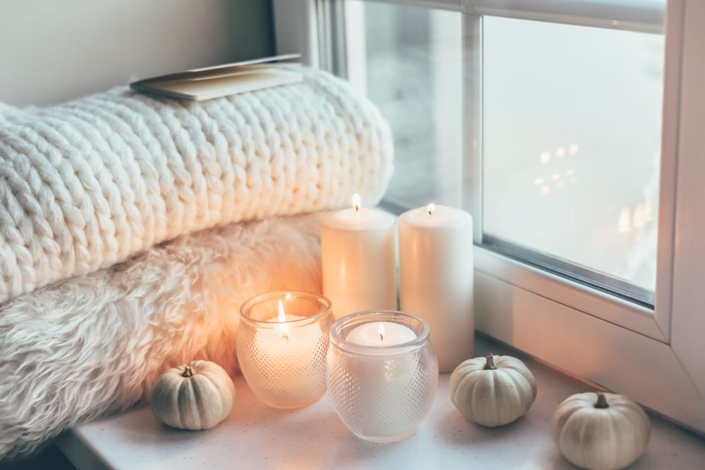 Cozy fall blankets and candles