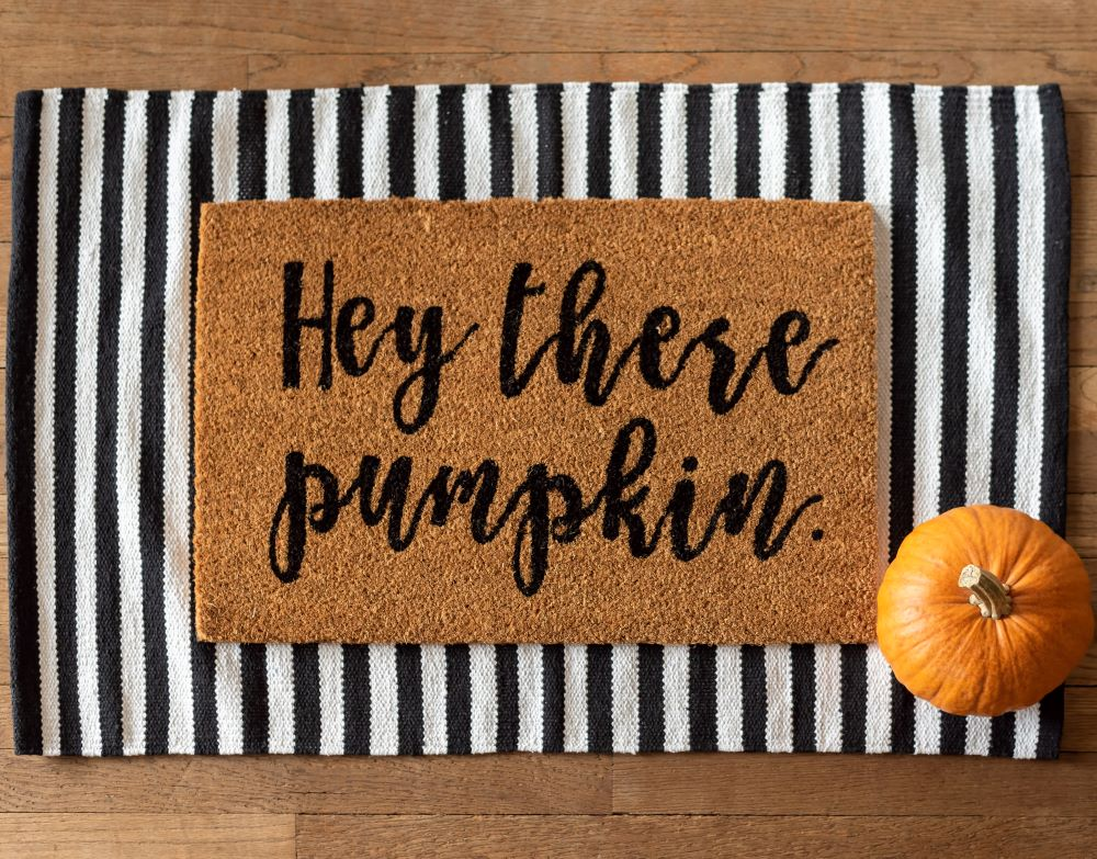Fall Porch Ideas - layered hey there pumpkin doormat