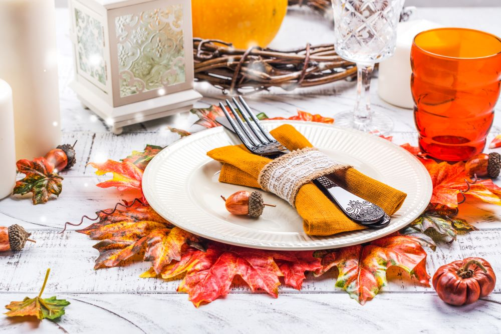 How To Style Your Dining Table For Fall - fall leaf placemat
