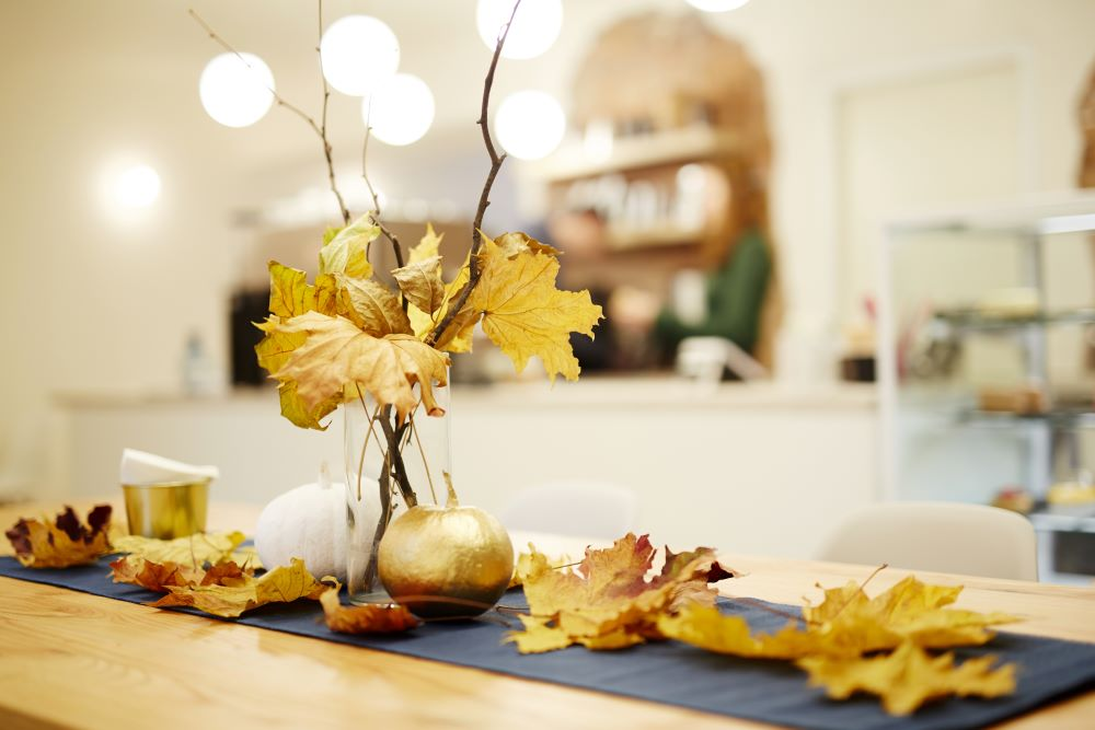 Ways To Decorate With Leaves - gold fall leaf display with pumpkins