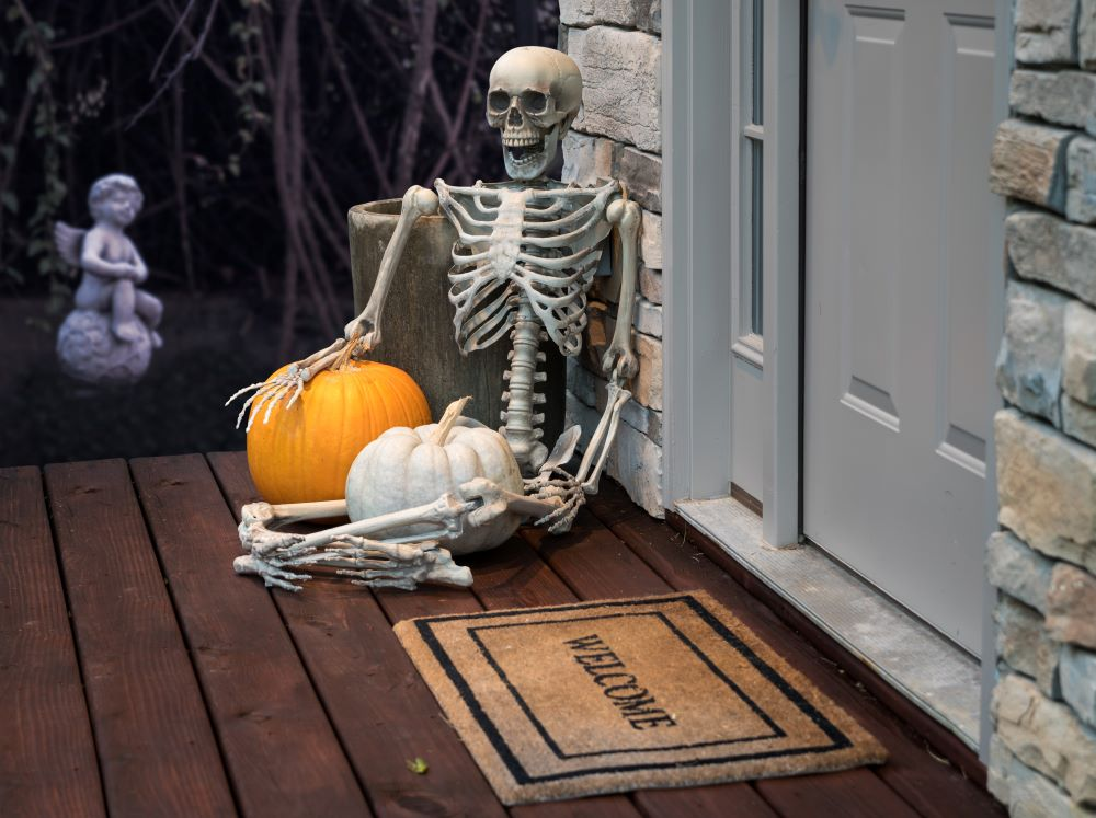 How To Transition The Porch From Fall To Halloween - skeleton porch